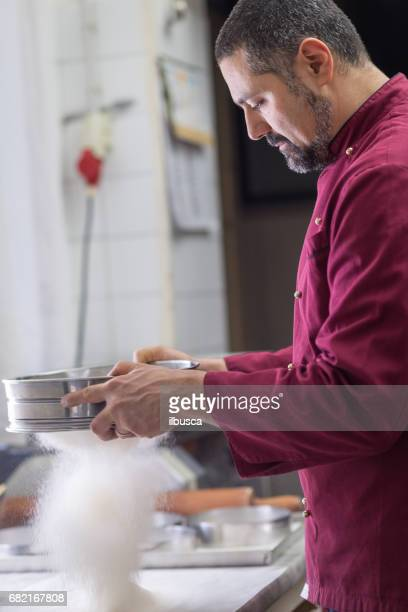 Italian pastry making patisserie baking confectioner: sifting flour