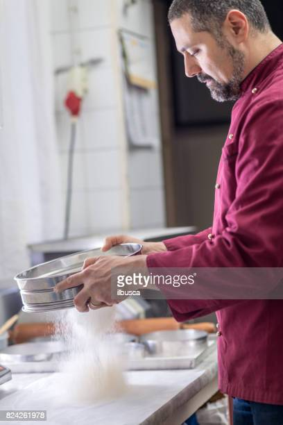 Italian pastry making patisserie baking confectioner: sifting ingredients