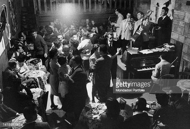 Italian people dancing into the 'Santa Tecla' nightclub accompanied by a jazz band Milan 11th December 1959