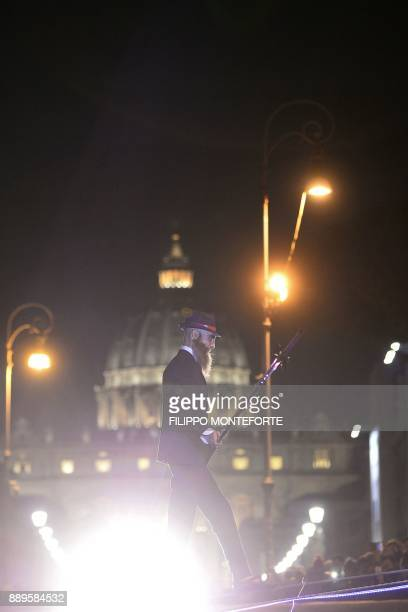 Italian performer and tightrope walker Andrea Loreni walks on a 135meterlong rope 20 meters above the Tiber river in downtown Rome on December 10...