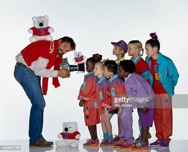 Italian photographer Oliviero Toscani photographs a group of children who are wearing Benetton clothing Toscani began his collaboration with the...