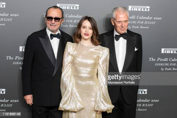 Italian photographer Paolo Roversi, british actress Claire Foy and Pirelli managing director Marco Tronchetti Provera during the presentation of the...