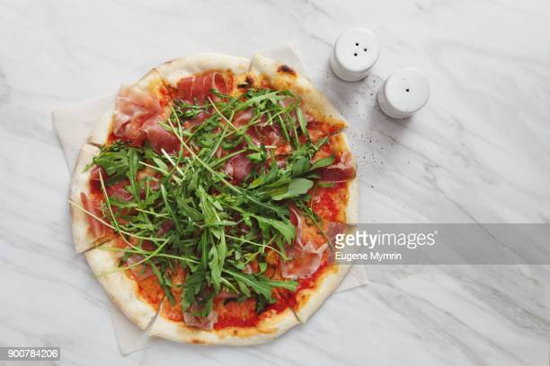 Italian pizza with parma ham and arugula