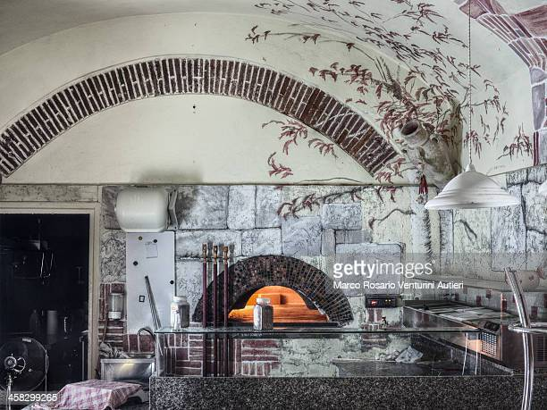 Italian pizzeria with wood-fired oven when the shop is closed