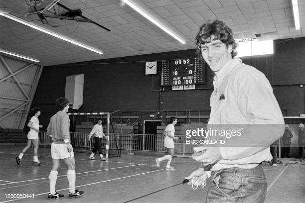 Italian player Paolo Rossi holds a stopwatch and a whistle and as he referees a friendly football match between France and Italy as part of the...