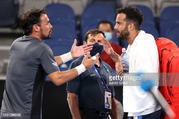Italian player Salvatore Caruso and Fabio Fognini argue after their men's singles match on day four of the Australian Open tennis tournament in...