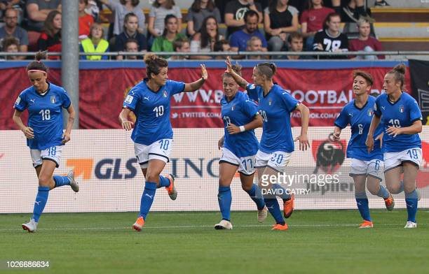 Italian players celebrate after scoring during the Women's 2019 World Cup qualification football match on September 4 2018 in Leuven / Belgium OUT