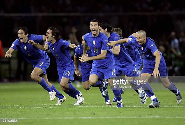 Italian players celebrate after teammate Fabio Grosso scores the matchwinning penalty during the FIFA World Cup Germany 2006 Final match between...