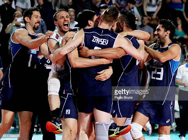 Italian players celebrate after winning the FIVB Volleyball World League match against Brazil at Foro Italico on June 19 2015 in Rome Italy
