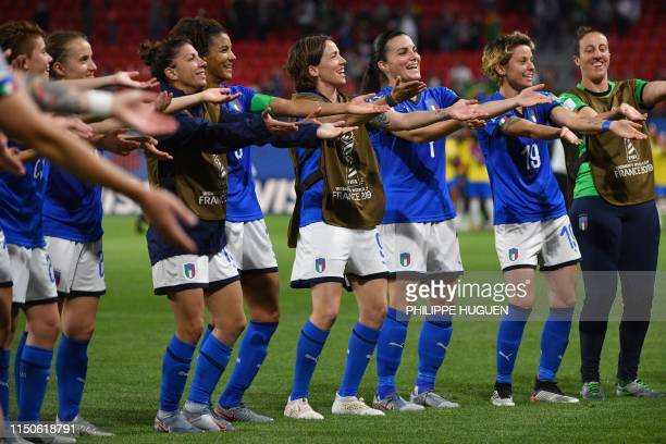 Italian players celebrate at the end of the France 2019 Women's World Cup Group C football match between Italy and Brazil on June 18 at the Hainaut...