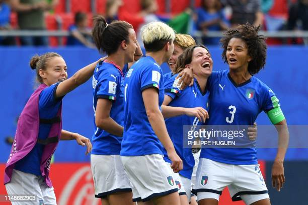 Italian players celebrate their victory at the end of the France 2019 Women's World Cup Group C football match between Australia and Italy on June 9...