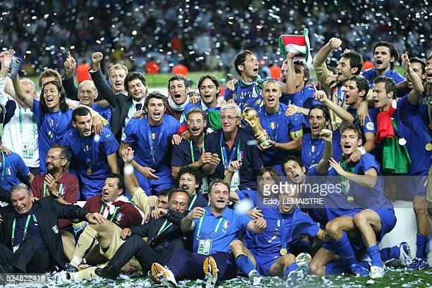 Italian players celebrate with the winner's trophy after the final of the 2006 FIFA World Cup between Italy and France.