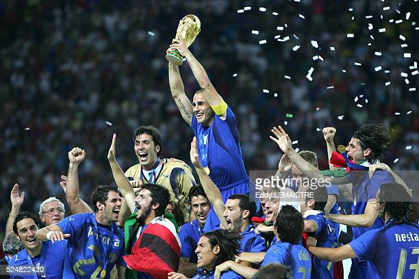 Italian players celebrate with the winner's trophy after the final of the 2006 FIFA World Cup between Italy and France