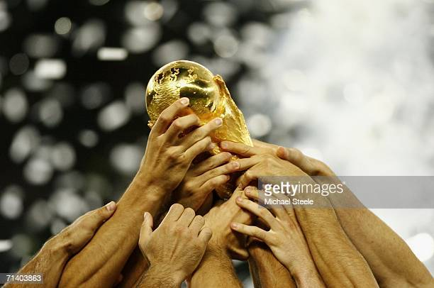 Italian players celebrate with the world cup trophy following their team's victory during the FIFA World Cup Germany 2006 Final match between Italy...