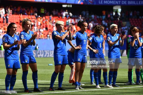 Italian players react at the end of the France 2019 Women's World Cup quarterfinal football match between Italy and Netherlands on June 29 at the...