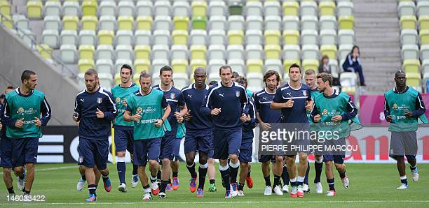 Italian players warm up during a training session in Gdansk on June 9 2012 during the Euro 2012 football championships AFP PHOTO/ PIERRE PHILIPPE...