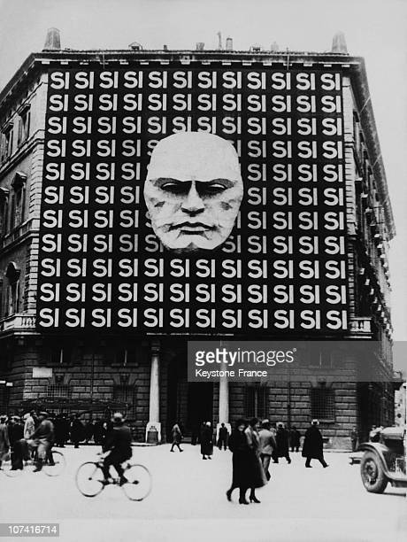 Italian Plebiscite Board With Si And Mussolini Portrait On The Facade Of A Building On March 1934