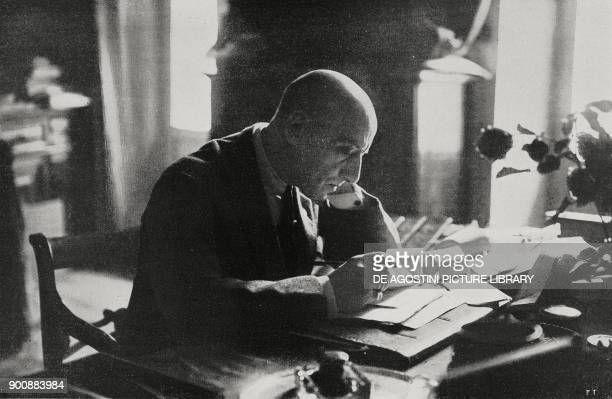 Italian poet Gabriele D'Annunzio in the study at his Vittoriale degli Italiani estate Gardone Riviera Italy from L'Illustrazione Italiana Year XLVIII...