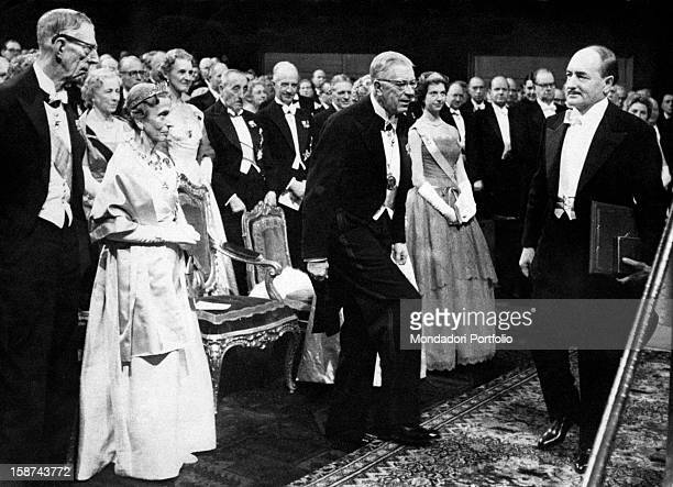 Italian poet Salvatore Quasimodo receiving the Nobel prize in literature in front of the Royal Highnesses the King Gustaf VI Adolf of Sweden and his...