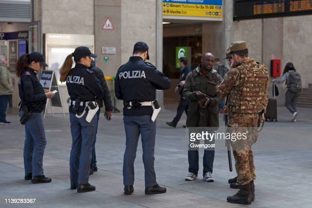 Italian police and army doing an identity check at the Genova Piazza Principe railway station