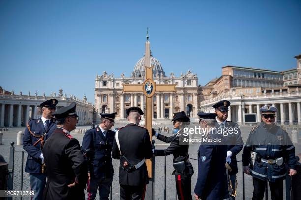 Italian Police and Carabinieri check St Peter's Square while Pope Francis celebrates the Easter Mass inside the empty St Peter's Basilica during the...