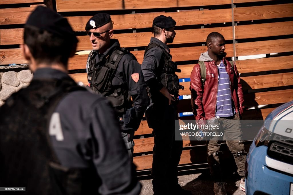Italian Police border officers prepare to check the papers of a