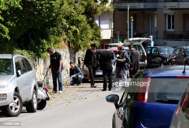 Italian police carry out investigations at the site where Roberto Adinolfi a 53yearold nuclear engineer was shot in Genoa on May 7 2012 Adinolfi head...