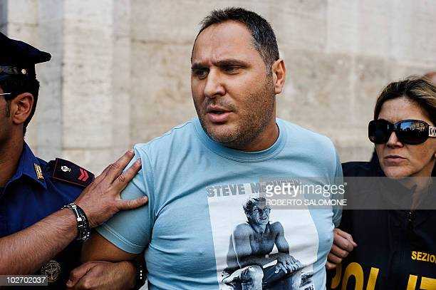 Italian Police escort camorra mafia organisation boss Cesare Pagano after his arrest in Licola on July 8, 2010. Cesare Pagano is one of the 30 most...