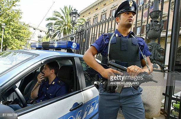 Italian police guard the US Embassy in Rome 11 August 2004 as they have identified up to 6000 potential targets of a terrorist attack in RomeTension...