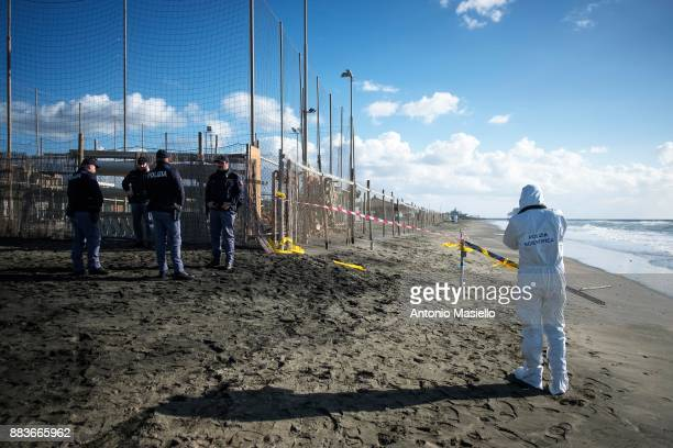 Italian Police investigate the scene where a man's body was found this morning by a passerby on the beach near Piazzale Magellano on December 1 2017...