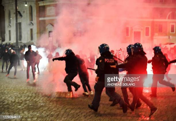 Italian police officers clash with far right Forza Nuova party activists during a protest against the government restriction measures to curb the...