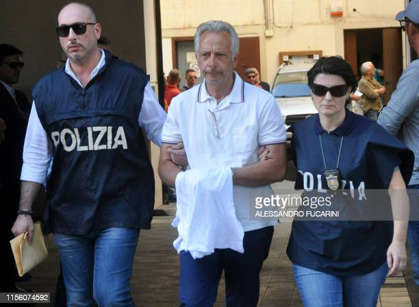 Italian police officers escort Francesco Inzerillo after he was arrested in Palermo during an police/FBI operation called 'New Connection' on July 17...