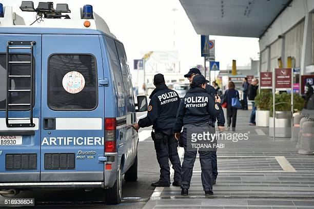 Italian police officers patrol at Rome's Fiumicino aiport on March 22 2016 as security measures were reinforced in the wake of attacks in Brussels...