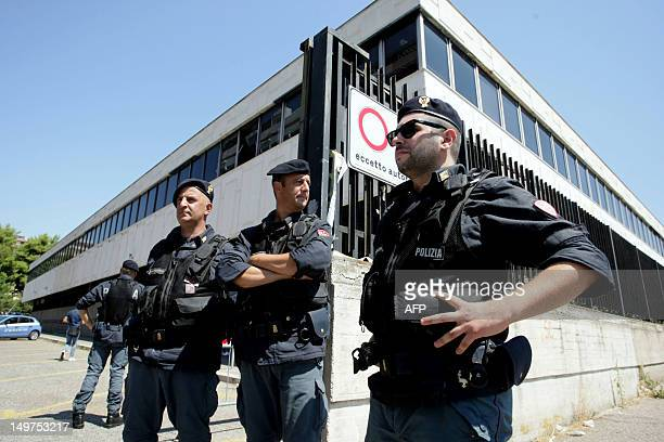 Italian police officers stand guard outside the court house in the southern Italian city of Taranto on August 3 2012 Today prosecutors will make a...