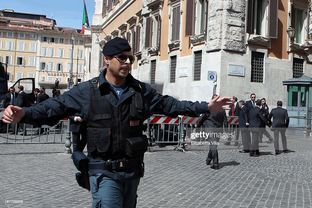 Italian police secure as they patrol around the area where gunshots were fired, in front of the Chigi Premier's office on April 28, 2013 in Rome, Italy.Two military police officers were shot in the square outside Palazzo Chigi while the new government of Enrico Letta was being sworn in. The attacker was caught and the authorities identified him as Luigi Preiti a unemployed man born in 1964 in Calabria.