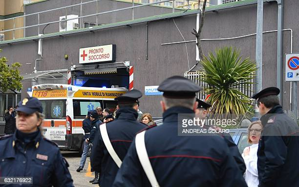 Italian police secure the area as an ambulance arrives at the Pescara Central hospital in the eastern coastal city of Pescara some 58 kilometer from...