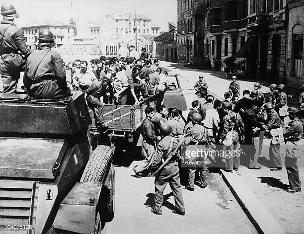 Italian police stop a truck carrying communist flying picketers during a national general strike, Italy, 19th July 1948. The strike has been called...