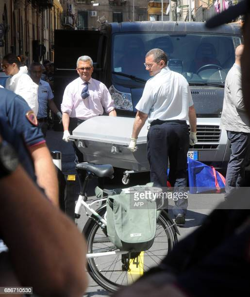 Italian police work on the site where mafia boss Giuseppe Dainotti was gunned down by two killers while riding his bike police said on May 22 2017 in...