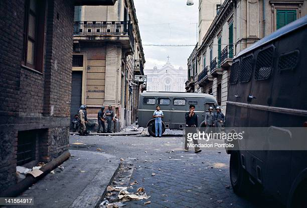 Italian policemen watching over a street in downtown Reggio Calabria during the disorder caused by the choice of the regional capital city. Reggio...