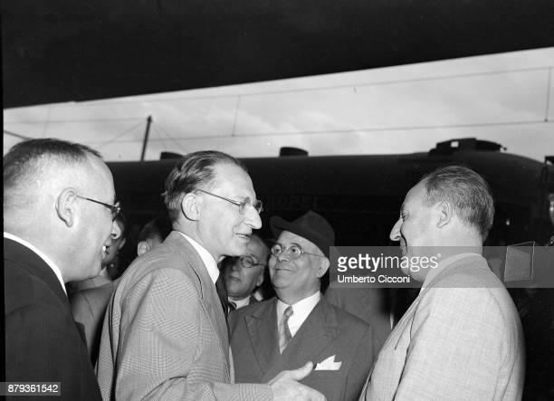 Italian politician Alcide De Gasperi talks to politician Giuseppe Saragat before he leaves for America Rome 1947