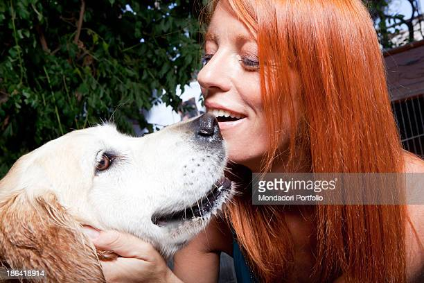 Italian politician and animalist Michela Vittoria Brambilla caressing a Golden Retriever dog at the lido Bau Bau Village. Albisola Marina, 22nd...