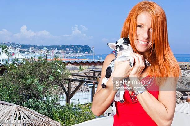 Italian politician and animalist Michela Vittoria Brambilla smiling with a Chihuahua dog in the hands at the lido Bau Bau Village Albisola Marina...