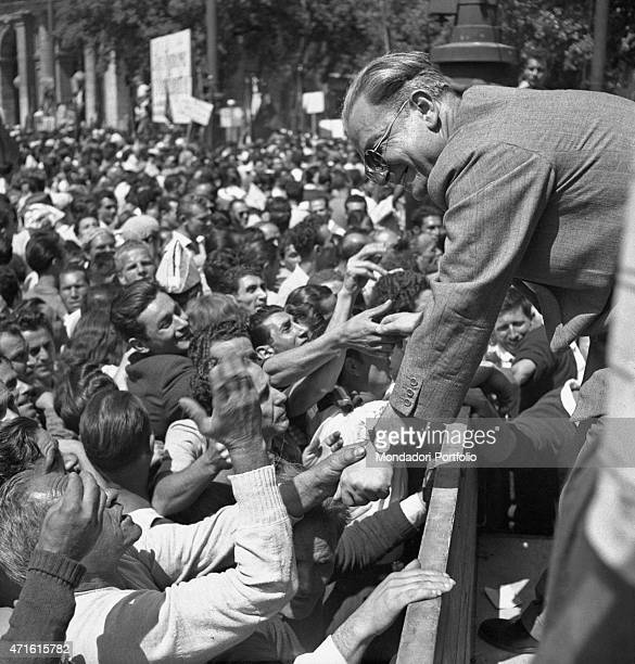 Italian politician and General Secretary of Italian Communist Party Palmiro Togliatti greeting the crowd after he was shot in Rome on 14th July Rome...