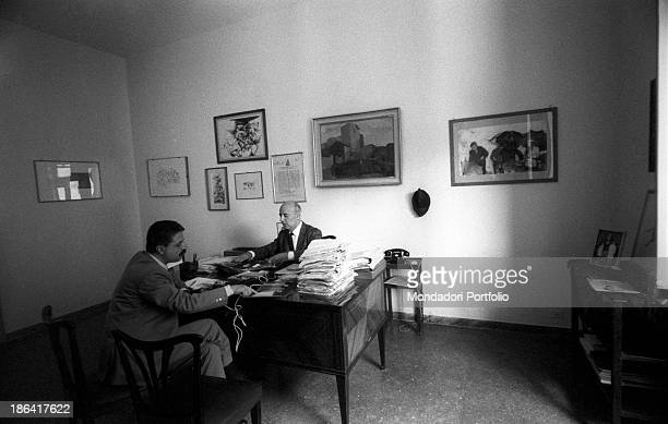 Italian politician and partisan Giancarlo Pajetta is interviewed by Italian journalist and writer Giorgio Torelli in his study in via delle Botteghe...