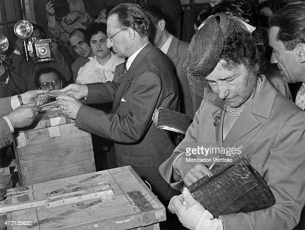 Italian politician and President of the Council of Ministers Alcide De Gasperi and his wife Francesco voting at the polls for Italian national...