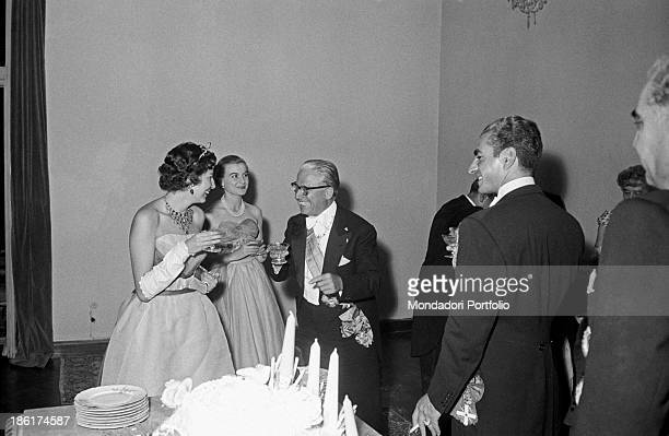 Italian politician and President of the Italian Republic Giovanni Gronchi his wife Carla and Her Imperial Highness Princess Soraya of Iran laughing...