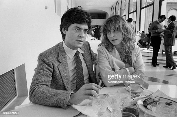Italian politician and vicesecretary of Italian Socialist Party Claudio Martelli sitting near Italian TV producer and politician Stefania Craxi...