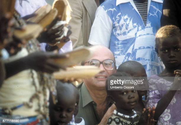 Italian Politician Bettino Craxi with children from Kenya during a political trip in Africa 1980