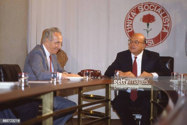 Italian politician Craxi is with politician Shimon Peres at the socialist party headquarters, Rome 1987.