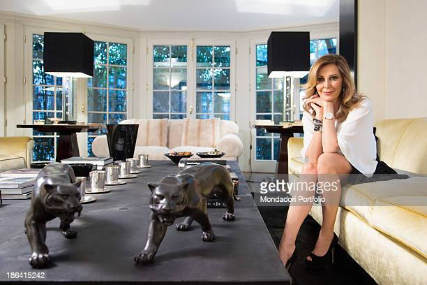 Italian politician Daniela Santanchè sitting on the sofa in the livingroom of her house Milan 27th April 2012
